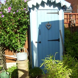 Garden shed beach hut for our small garden made from some recycled wood and paint bought from Perrywood. Cindy & John
