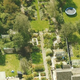 The aerial photograph was taken in 2014 and marked the end of our 5 year project to redesign and construct our garden, which is approx 275 ' long, after moving to Tolleshunt Knights in 2009. It shows the various elements rather than detail. Clive & Eleanor Young