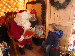 Father Christmas checks his Christmas list book