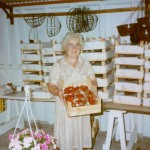 Mary Bourne with a strawberry crop, sold here before Alan & Karin Bourne took over in 1984 and focused on plants