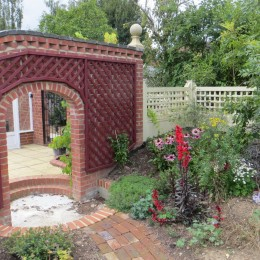 Trellised archway in the wall dividing the cottage and the vegetable gardens. Peter French